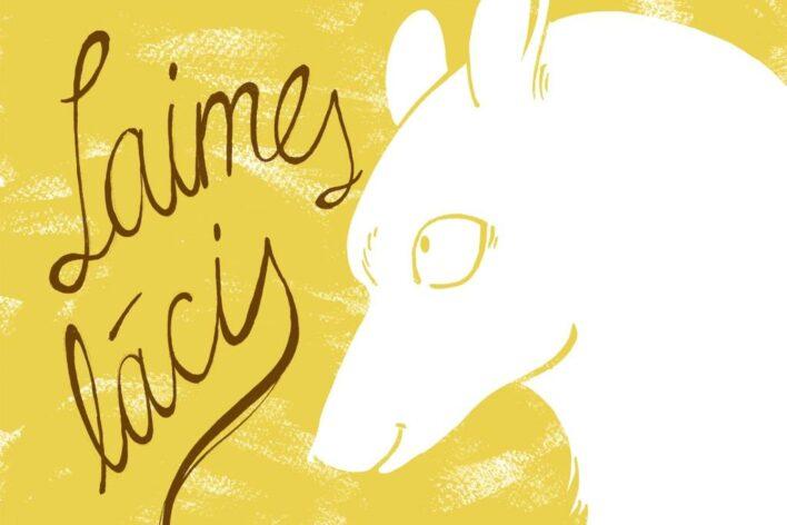 """Uz dzeltena fona uzzīmēta balta lāča galva. Lācis skatās pa kreisi, kur ir uzraksts """"Laimes lācis"""""""